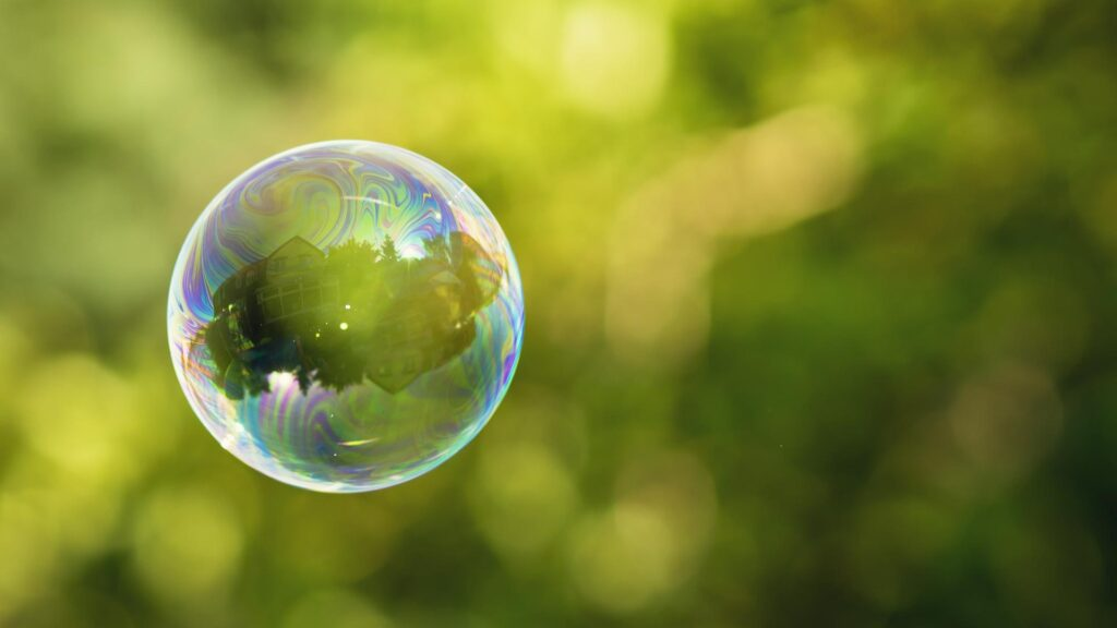 Bubble floating with green in background