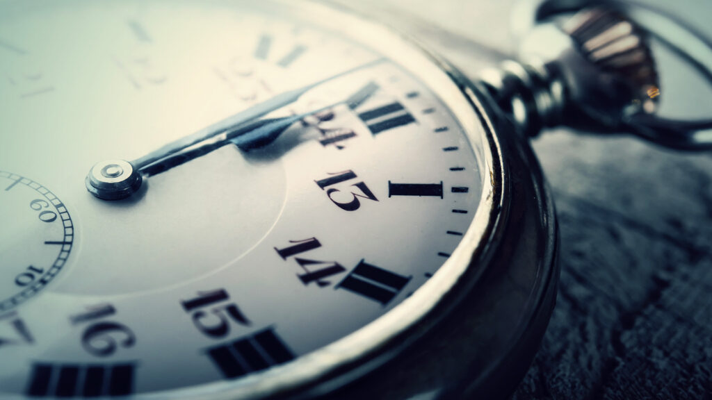 Pocket watch ticks towards midnight