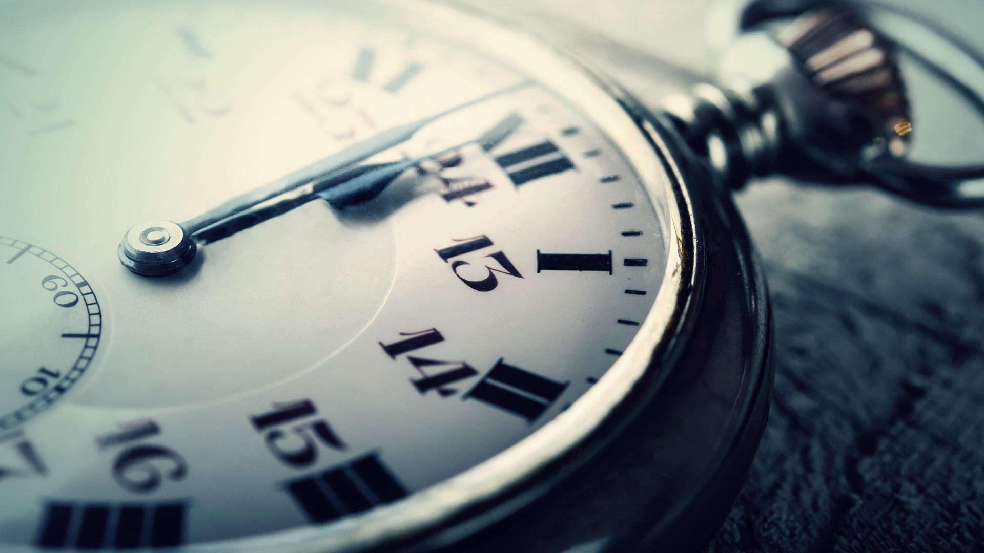 Pocket watch ticks towards midnight