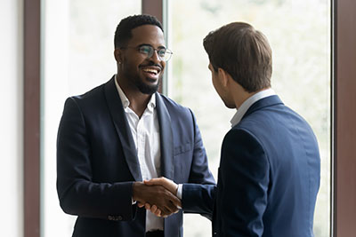 Financial Advisor shaking hands with his client