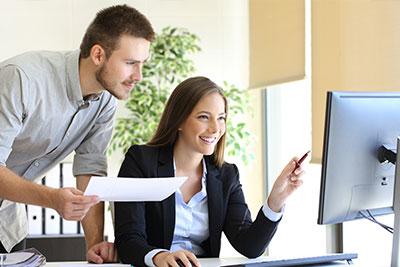 Financial Advisor at a computer